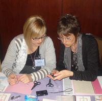 Sara and Shelli picking their scissor charm